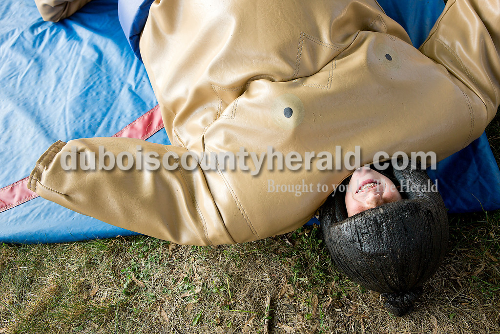 Chloe Schaefer of Santa Claus, 9, giggled after falling repeatedly while sumo wrestling her brother Kort, 11, during the Heinrichsdorf's Fest in St. Henry on Friday. Rachel Mummey/The Herald
