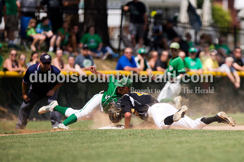 Jasper's Evan Aders slid safe into third plate and collided with West Vigo's Braiden Cardinal during Saturday's Class 3A semistate championship at Ruxer Field in Jasper. The Wildcats won 6-0. <br /> <br /> Alisha Jucevic/The Herald