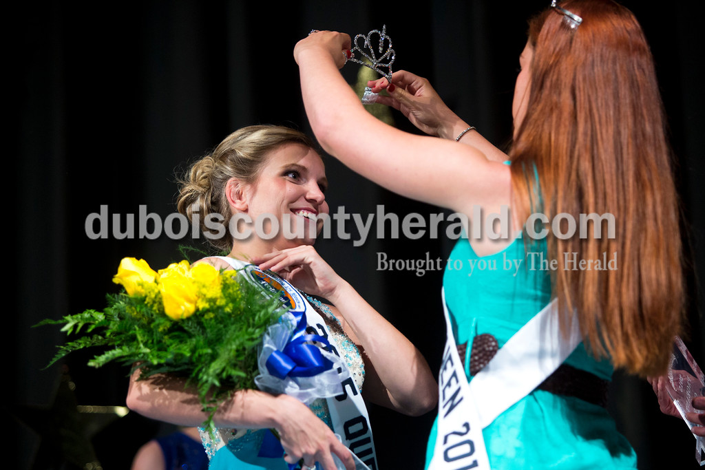 2014 Miss Heimatfest Shelby Klem of Ferdinand, 18, crowned Miss Ferdinand 175, Kayla Hoffman of Ferdinand, 18,  at the Ferdinand  175th Queen Pageant on Sunday evening in the auditorium at Forest Park High School in Ferdinand. <br /> <br /> Alisha Jucevic/The Herald