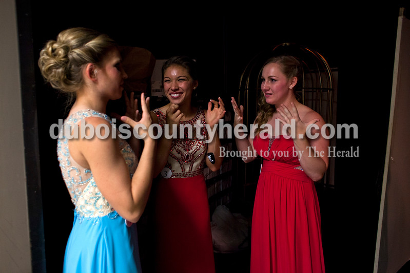 Ferdinand 175th Pageant queen Kayla Hoffman, 18, first runner-up Lauren Tretter, 16, and Mackenzie Voegerl, 16, all of Ferdinand, shared a moment backstage at the Ferdinand 175 Queen Pageant on Sunday evening in the auditorium at Forest Park High School in Ferdinand. <br /> <br /> Alisha Jucevic/The Herald