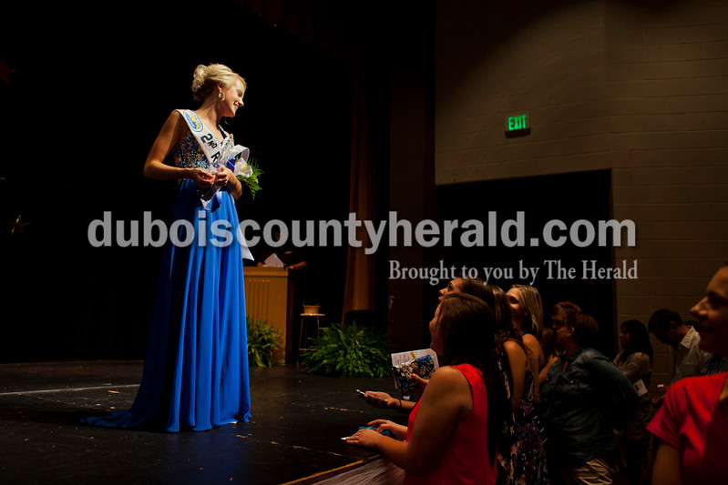 Gabrielle Hoffman of Ferdinand, 17, talked with her friends after the Ferdinand 175th Queen Pageant on Sunday evening in the auditorium at Forest Park High School in Ferdinand. <br /> <br /> Alisha Jucevic/The Herald