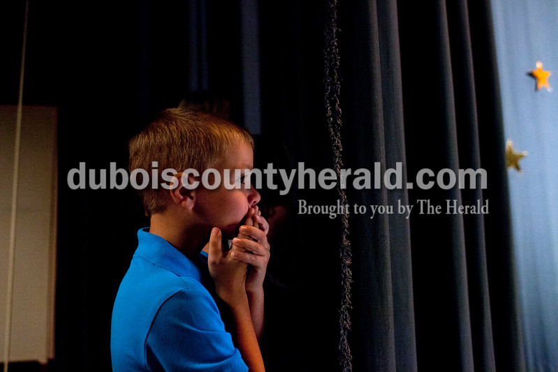 Little Mister Photogenic and second runner-up Layton Lubbehusen of Ferdinand, 6, watched his fellow contestants enter the stage for introductions on Sunday afternoon at the Ferdinand 175th Little Miss and Mister Pageant in the auditorium at Forest Park High School in Ferdinand. <br /> <br /> Alisha Jucevic/The Herald