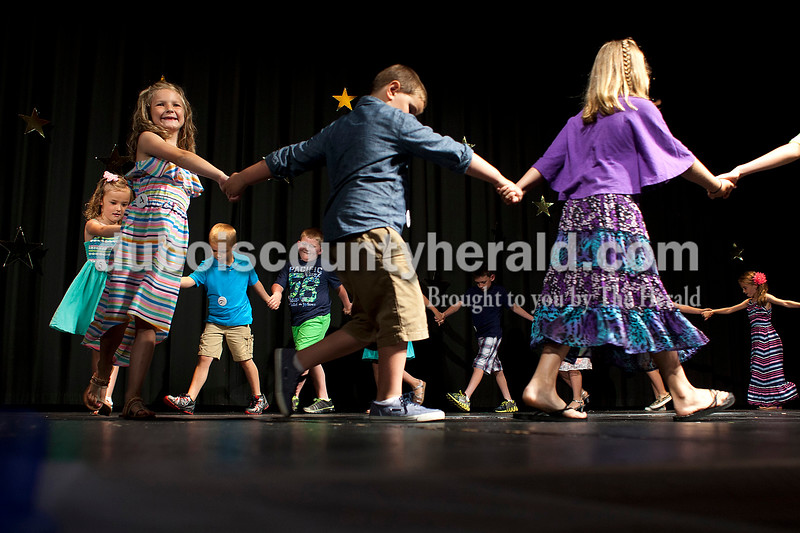 Bailey Anderson of Ferdinand, 7, smiled out at the crowd as the Little Miss and Little Mister contestants performed a dance on Sunday afternoon at the Ferdinand 175 Little Miss and Mister Pageant in the auditorium at Forest Park High School in Ferdinand.  Bailey was named Little Miss Ferdinand. More photos from the event are at DuboisCountyHerald.com.