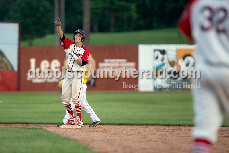 Dubois County's Drake McNamara signaled toward his teammates after hitting a double during Monday night's Bombers game against the Madisonville Miners at League Stadium in Huntingburg. The Bombers won 13-1. Ariana van den Akker/The Herald