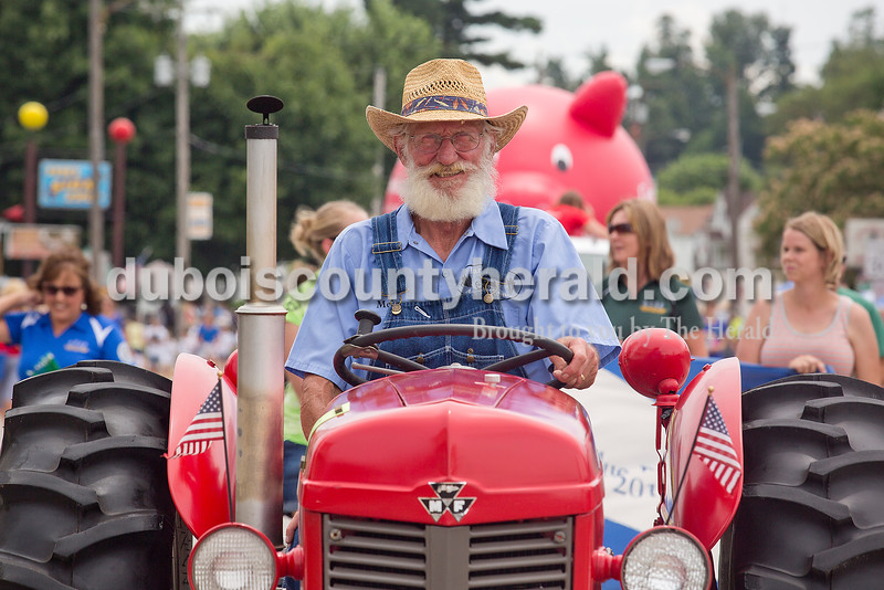 Melvin Daunhauer of Ferdinand drove a tractor during the parade for the Ferdinand 175th Celebration on Sunday. Rachel Mummey/The Herald