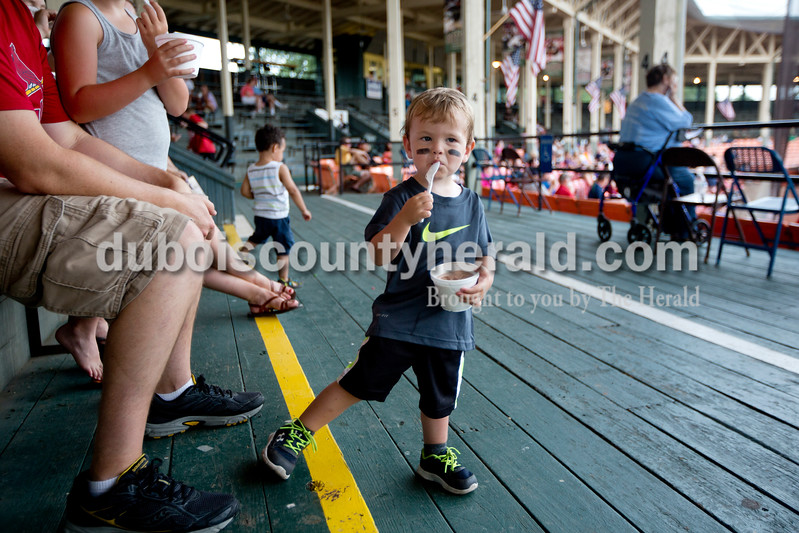 Declan Nord of St. Anthony, 2, snacked on ice cream at Monday night's Bombers game against the Madisonville Miners at League Stadium in Huntingburg. The Bombers won 13-1. Ariana van den Akker/The Herald