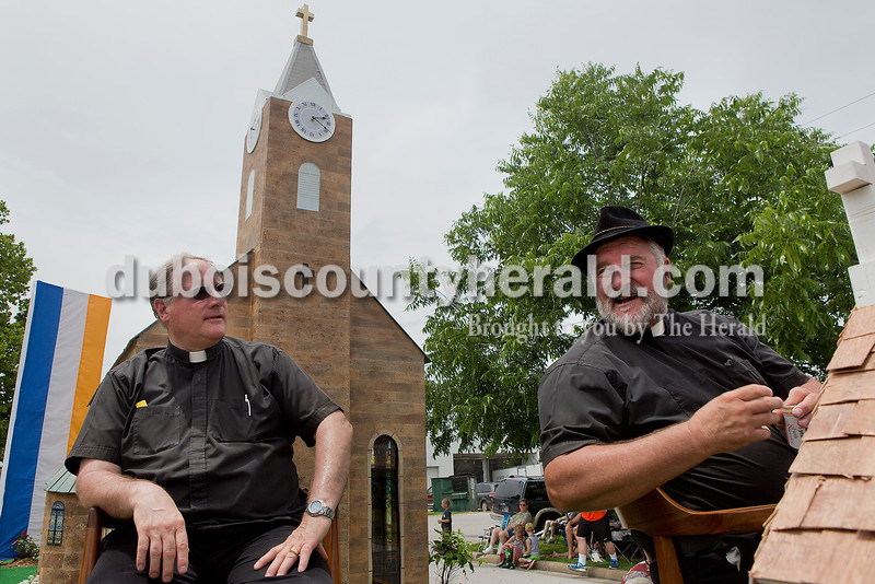 Father Jim Durchholz, left, and his twin brother Jack, playing the role of Father Joseph Kundeck rode on the St. Ferdinand Catholic Church float during the parade for the Ferdinand 175th Celebration on Sunday. Rachel Mummey/The Herald