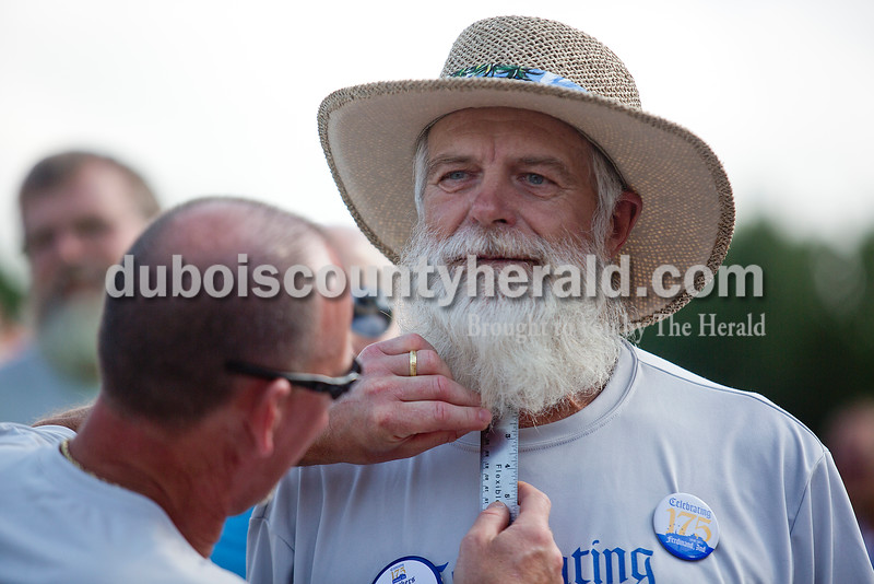 Kenny Oeding of Ferdinand had his beard measured by judge Luke Tieken of Ferdinand at the judging of the Brothers of the Brush competitions at 18th St. Park during the Ferdinand 175th Celebration on Saturday. Rachel Mummey/The Herald