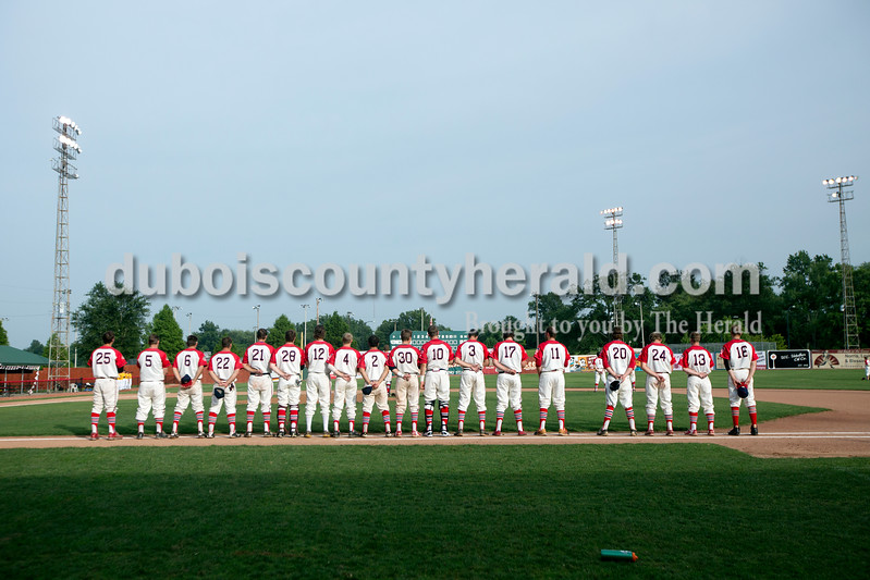 The Dubois County Bombers lined up for the National Anthem before Monday night's Bombers game against the Madisonville Miners at League Stadium in Huntingburg. The Bombers won 13-1. Ariana van den Akker/The Herald