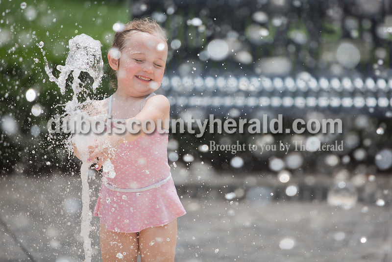 Marissa Wolf of Jasper, 3, played in the water fountain at Central Green next to the Cabby O'Neill Gymnasium in Jasper on Monday. Rachel Mummey/The Herald