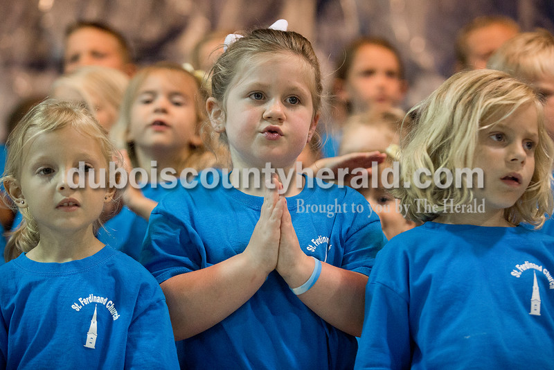 Kindergartners Jalyn Schulz, Alivia Hoppenjans and Mya Hickerson sang during their final performance from St. Ferdinand Vacation Bible School at the Ferdinand Community Center during the Ferdinand 175th Celebration on Friday. The children raised $751.13. Rachel Mummey/The Herald