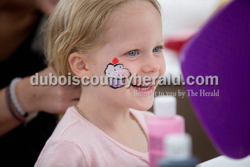 Frances Bailey of Denver, Co., 3, checked out her freshly painted face at 18th St. Park during the Ferdinand 175th Celebration on Saturday. Frances' mother is originally from Ferdinand and they came back for the celebration. Rachel Mummey/The Herald