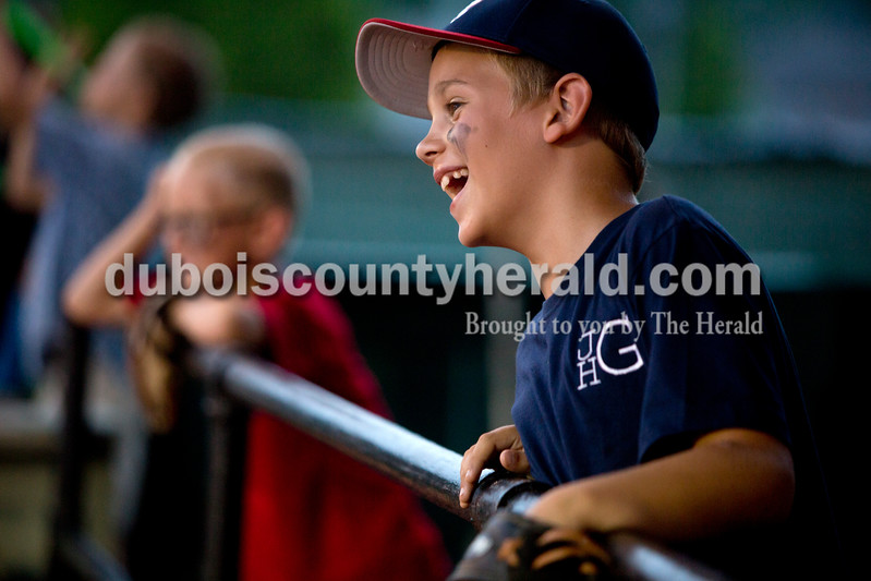 Josh Gardiner of Loogootee, 8, watched the bat spin race during Monday night's Bombers game against the Madisonville Miners at League Stadium in Huntingburg. The Bombers won 13-1. Ariana van den Akker/The Herald