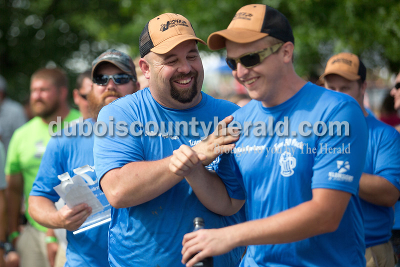 Mike Mullen of St. Anthony, left, congratulated teammate Riley Fleetwood of Jasper during the award ceremony for the Backyard BBQ contest at 18th St. Park during the Ferdinand 175th Celebration on Saturday. Rachel Mummey