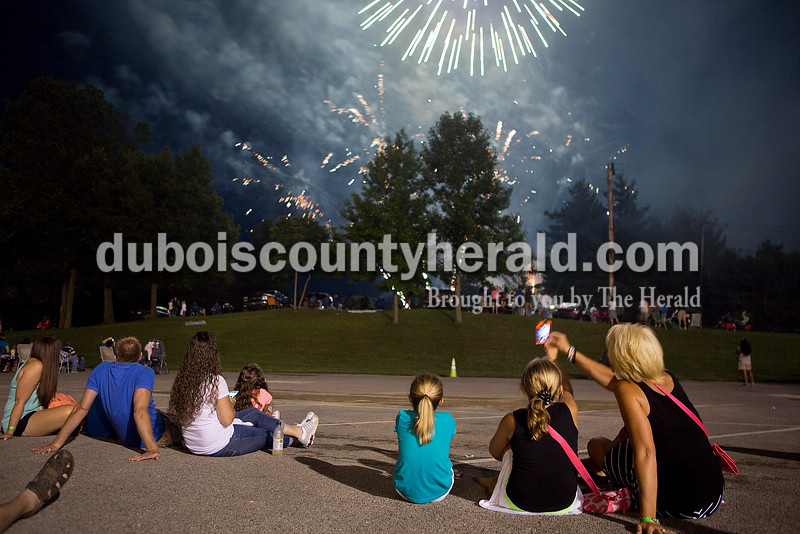 Lori Persohn, right, her daughter Carrington, 8, and friend Hannah Schultz, 8, all of Ferdinand, watched the fireworks at 18th St. Park during the Ferdinand 175th Celebration on Saturday. Rachel Mummey/The Herald