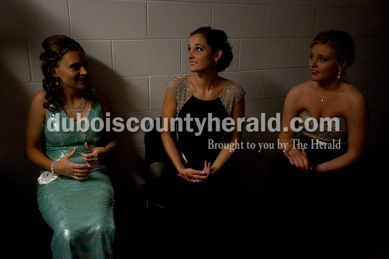 Erica Lafser/The Herald<br /> Melissa Mutchman of Huntingburg, 17, left, sat with Emily Gutgsell of Schnellville, 19, middle, and Sarah Reckelhoff of Jasper, 19, right. The girls talked about their nerves before walking down the runway for the Miss Formal Wear Competition portion of their evening in the 2015 Dubois County 4-H Fair Queen Contest on Sunday in the gym at Jasper High School, with 14 women competing for the crown. Gutgsell won first runner up.