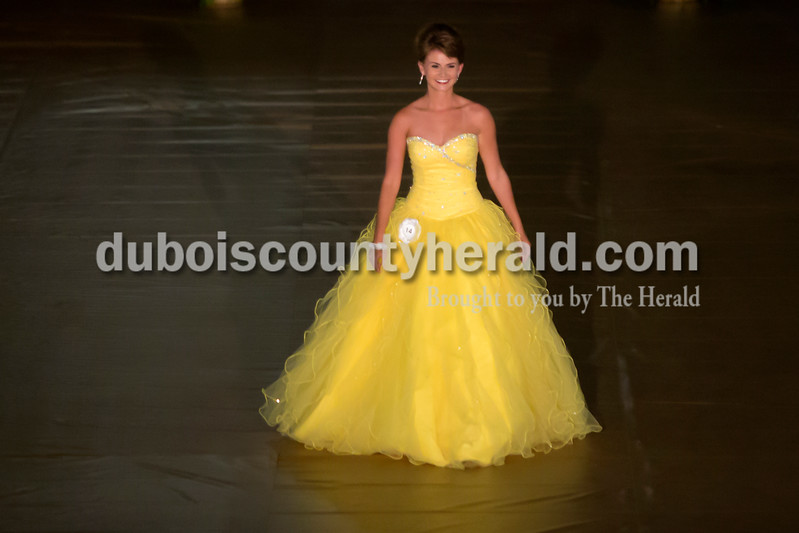 Erica Lafser/The Herald<br /> Moriah Fleck of St. Anthony, 18, walked down the runway set up in the gym at Jasper High School for the 2015 Dubois County 4-H Fair Queen Contest on Sunday, with 14 women competing for the crown. Fleck was announced 2015 Miss Dubois County and won Miss Photogenic.