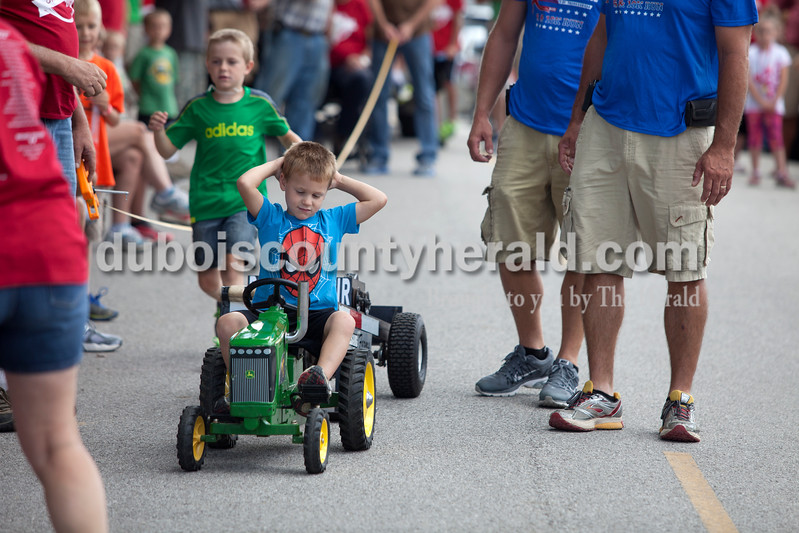 Erica Lafser/The Herald<br /> Griffin Beckman of Celestine, 4, competed in the kid's tractor pull event on Saturday at the Celestine Streetfest. This is a yearly town festival that occurs on the last Saturday in June.