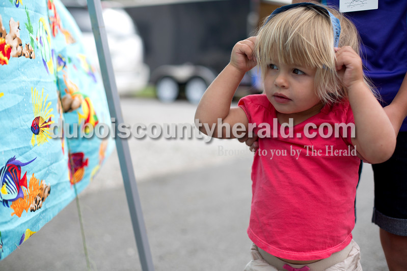Erica Lafser/The Herald<br /> Kaelyn Goepfrich of Celestine, 1, attended the Celestine Streetfest on Saturday. This is a yearly town festival that occurs on the last Saturday in June.
