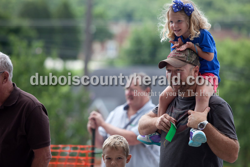 Erica Lafser/The Herald<br /> Josie Welp of St. Anthony, 4, sat on her dad Bobby Welp's, of St. Anthony, shoulders during the races on Saturday at the Celestine Streetfest. This is a yearly town festival that occurs on the last Saturday in June.