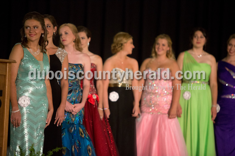 Erica Lafser/The Herald<br /> Melissa Mutchman of Huntingburg, 17, far left, stood before the crowd at the 2015 Dubois County 4-H Fair Queen Contest on Sunday in the gym at Jasper High School, with 14 women competing for the crown.