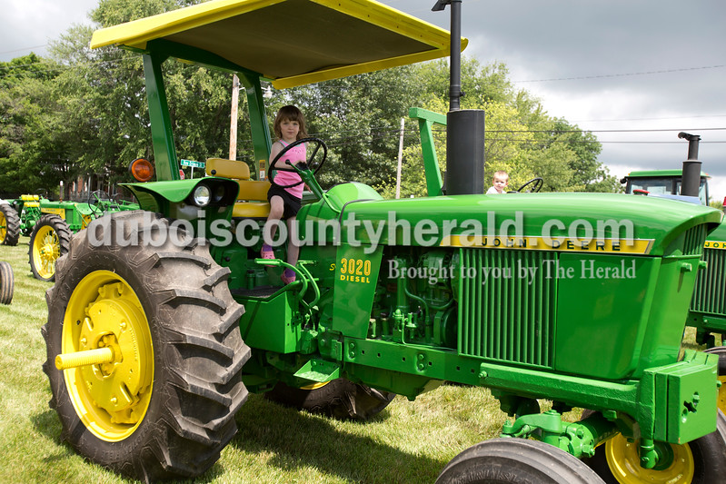 Erica Lafser/The Herald<br /> Allison Hasenour of Celestine, 3, looked at and experienced sitting in tractors much larger than herself on Saturday at the Celestine Streetfest. This is a yearly town festival that occurs on the last Saturday in June.