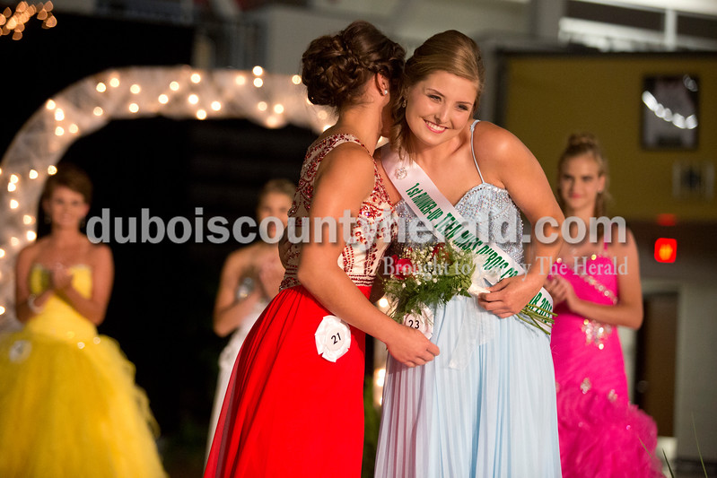 Erica Lafser/The Herald<br /> Lauren Tretter of Ferdinand, 16, left, hugged Melanie Roberts of Dubois, 16, right, when Tretter was announced Teen Miss Dubois County. Roberts won Teen Miss first runner up. The 2015 Dubois County 4-H Fair Queen Contest happened on Sunday in the gym at Jasper High School, with 14 women competing for the crown. These are two of the seven women that make up the 2015 Fair Queen Court.