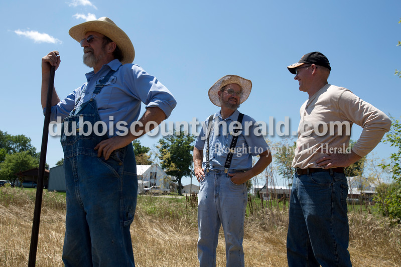 Erica Lafser/The Herald<br /> Randy Mathies of Huntingburg stood with Ed Vebelhor of Schnellville and Stan Stetter of Schnellville while they shared a laugh during the Schnellville Sesquicentennial wheat threshing on Sunday at the field outside of the Schnellville Community Club. This event occurs every 25 years.