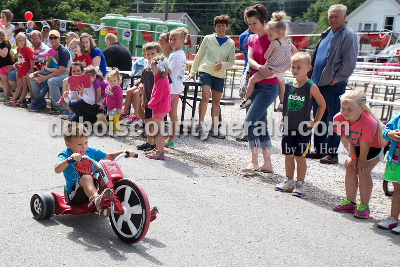 Erica Lafser/The Herald<br /> Griffin Beckman of Celestine, 4, raced a tricycle at the Celestine Streetfest on Saturday. This is a yearly town festival that occurs on the last Saturday in June.