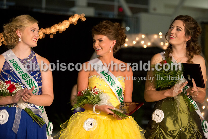 Erica Lafser/The Herald<br /> Jessica Hilsmeyer of Huntingburg, 17, left, stood with Moriah Fleck of St. Anthony, 18, middle, and Jade Hoffman of Celestine, 18, right, when Fleck was announced the 2015 Miss Dubois County. Fleck also won Miss Photogenic. Hilsmeyer won third runner up and Hoffman won Miss Congeniality. The 2015 Dubois County 4-H Fair Queen Contest took place on Sunday in the gym at Jasper High School, with 14 women competing for the crown.