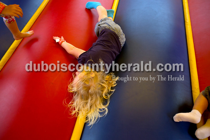 "Erica Lafser/The Herald<br /> Shylee Enlow of Celestine, 3, bounced on one of the inflatables at the Celestine Streetfest on Saturday. This is a yearly town festival that occurs on the last Saturday in June. ""She has been so excited about this,"" said Enlow's mother, Hannah Humbert of Celestine."
