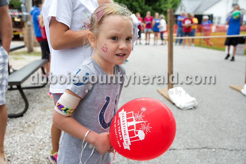 Erica Lafser/The Herald<br /> Macy Betz of Indianapolis, 5, looked with anticipation at the other kids racing at the Celestine Streetfest on Saturday. This is a yearly town festival that occurs on the last Saturday in June.