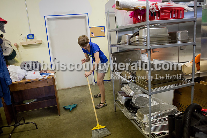Becca Schitter of Jasper, 13, swept the floors at the Community Meal Kitchen at St. Vincent de Paul as part of service project in conjunction with Rock Your Faith in Jasper on Tuesday. Rachel Mummey/The Herald