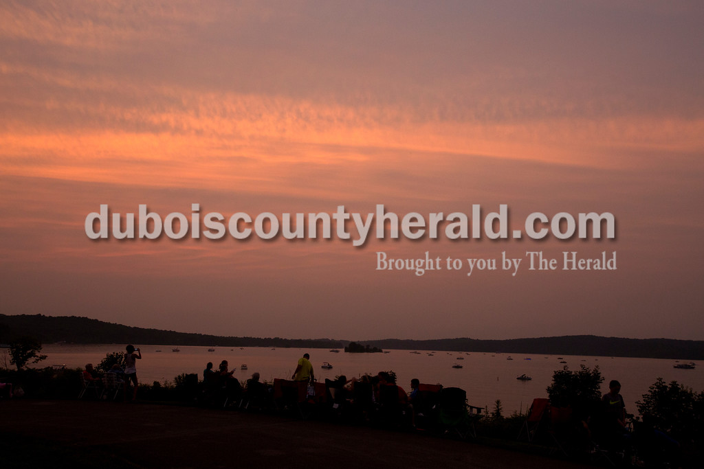 Erica Lafser/The Herald<br /> People on land and on water gathered on Saturday evening at Patoka Lake for Thunder over Patoka. Since the beach at Patoka Lake flooded, everyone was relocated to a higher parking lot.