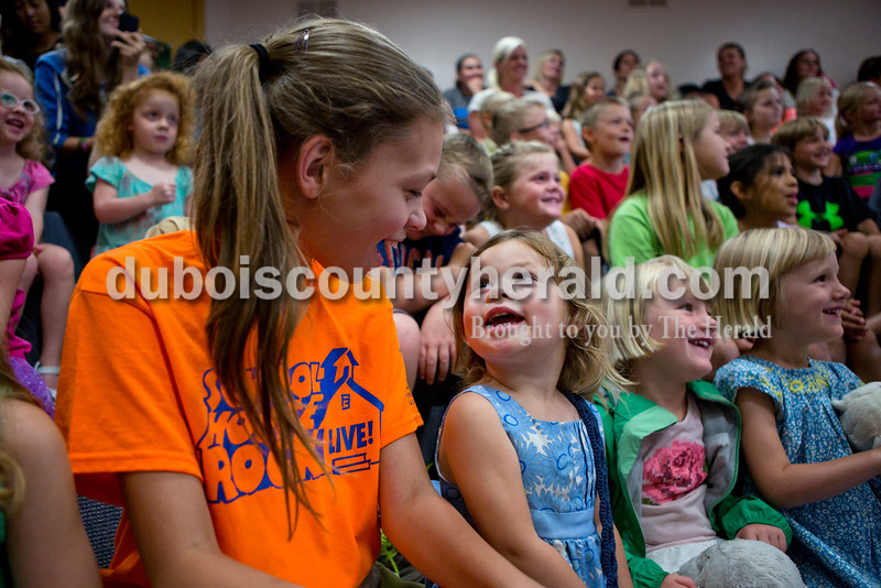 Landry Lueken, 2, looked up at her sister Faustina Lueken, 12, both of Jasper, in excitement after seeing a fennec fox at the Silly Safaris event on Tuesday afternoon at the Jasper Public Library. <br /> Alisha Jucevic/The Herald