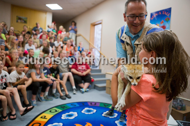 Katherine Trevino of Jasper, 5, held a fennec fox during the Silly Safari event on Tuesday afternoon at the Jasper Public Library. The event explored how superpowers can exist in the wild. <br /> <br /> Alisha Jucevic/The Herald