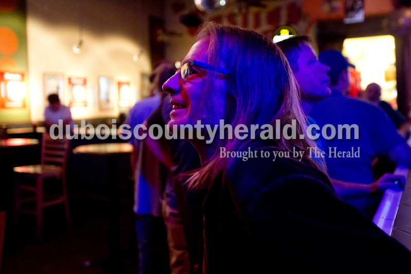 Ariana van den Akker/The Herald<br /> Brian Borman of Huntingburg listened to the performance by Sparrow and Crandall at open mic night at the Gaslight in Huntingburg on Thursday. The Gaslight will be celebrating its 45th anniversary this Friday. Borman played bass later in the night.