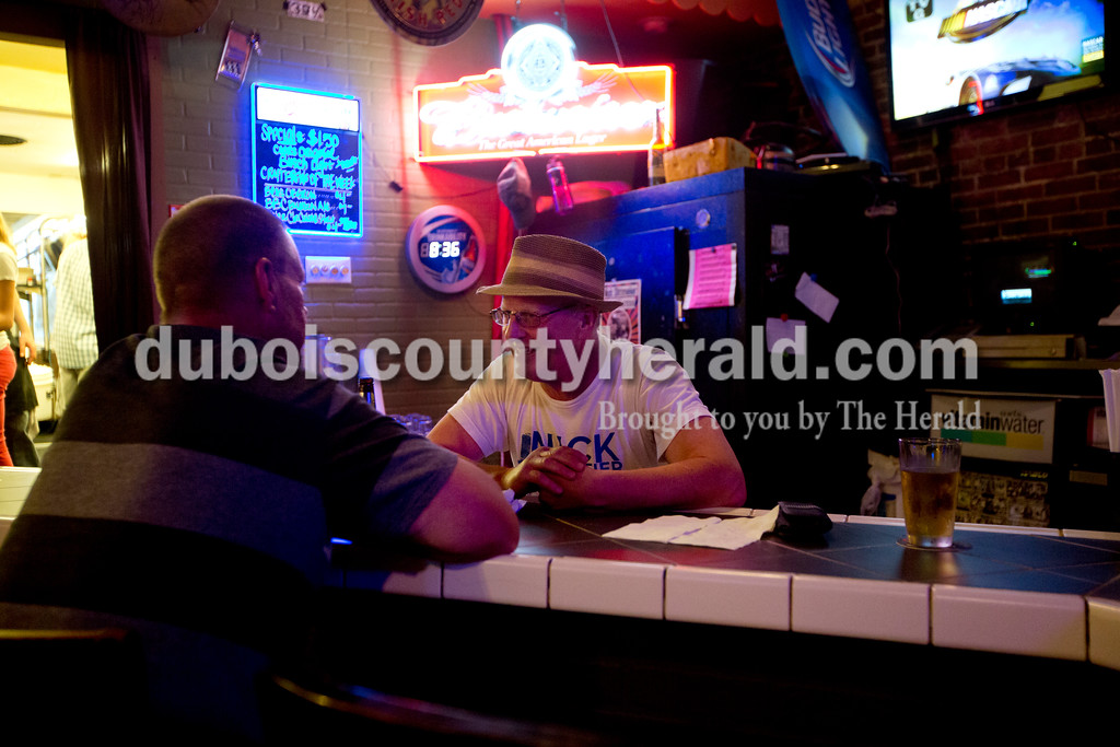 Ariana van den Akker/The Herald<br /> Joe Songer, right, chatted with Keith Horton, both of Huntingburg, before open mic night at the Gaslight in Huntingburg on Thursday. The Gaslight will be celebrating its 45th anniversary this Friday.