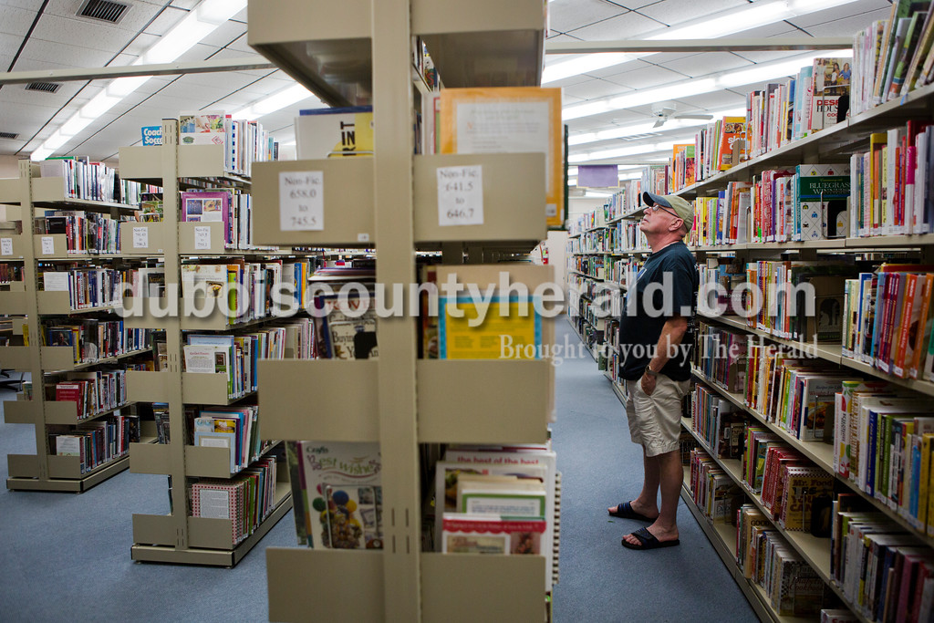 """Bob Hochstetler of Jasper seached the bookshelves for a Cajun cookbook on Tuesday afternoon at the Jasper Public Library. """"This is really a small library for a town this size,"""" said Hochstetler. <br /> Alisha Jucevic/The Herald"""