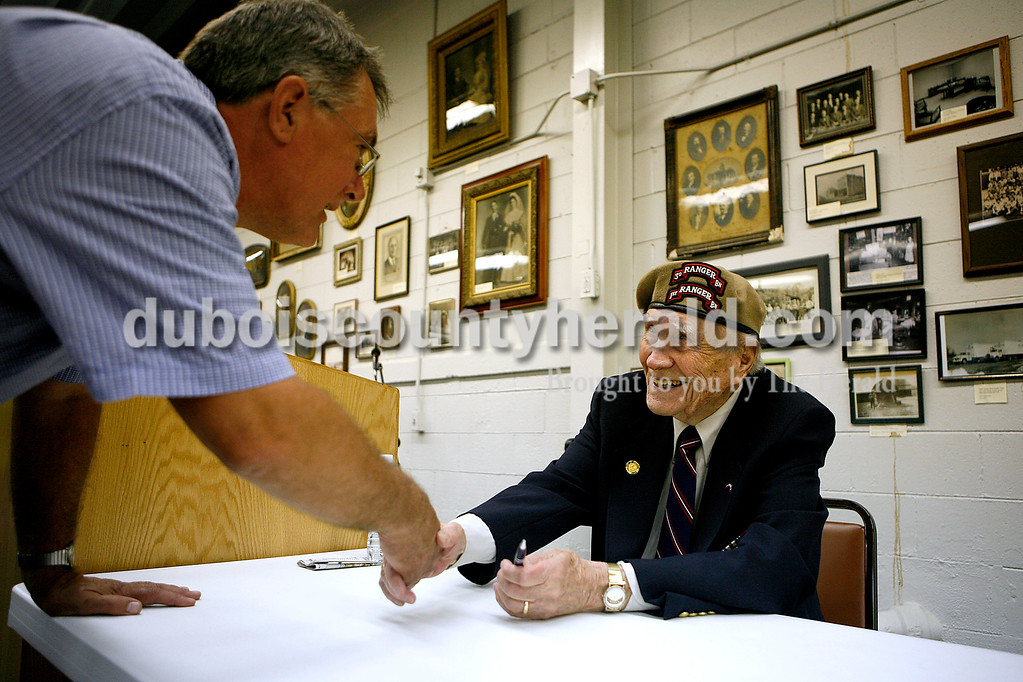 World War II veteran Warren Evans, 90,  signed autographs and shook hands following his speech at the Dubois County Museum in 2008. Evans, of Huntingburg, was captured and escaped three times during the war.