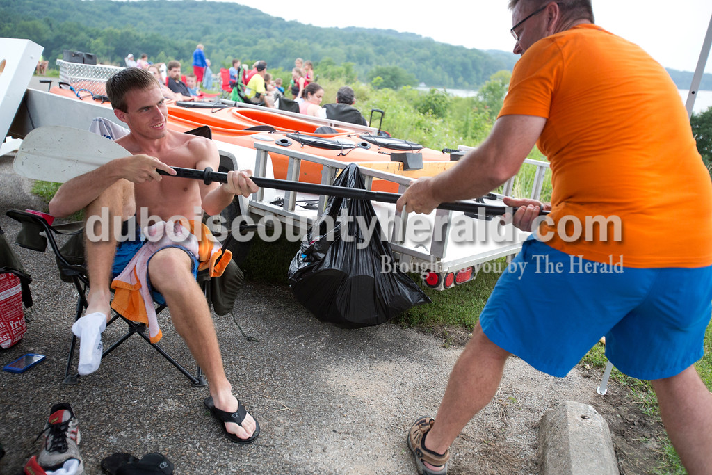 Erica Lafser/The Herald<br /> Jason Buechlein of Jasper, left, helped Steve Wigand of Jasper take apart a paddle from Wigand's kayak so they could put everything away before the fireworks on Saturday evening at Patoka Lake for Thunder Over Patoka. Since the beach at Patoka Lake flooded, everyone was relocated to a higher parking lot.