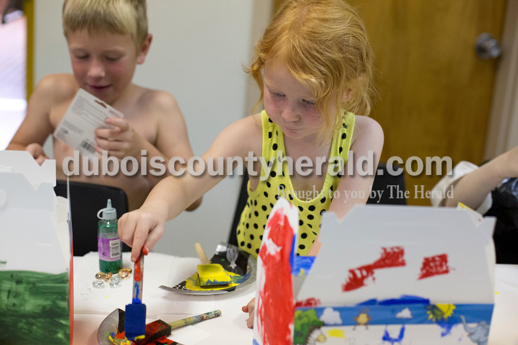 Erica Lafser/The Herald<br /> Drake Hagan of Jasper, 6, left, painted a treasure chest alongside his sister Bailey Hagan of Jasper, 3, right, on Sunday during the Patoka Lake's Pirate Day Celebration at the Patoka Lake Nature Center. These pirate activities were supposed to take place at the beach, but since it was flooded they had to relocate to the nature center.