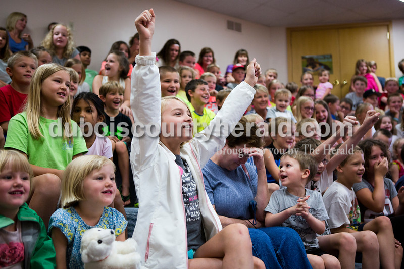 """Madelyn Day of Jasper, 9, held her arms up in excitement as she saw """"Amazon John"""", John Cusson, reveal a tarantula during the Silly Safaris workshop on Tuesday afternoon at the Jasper Public Library. <br /> Alisha Jucevic/The Herald"""
