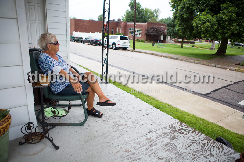 """Katie Sears of Jasper sat on her porch across from the Jasper Public Library on Tuesday afternoon. """"I come out here everyday, unless it's so cold I can't be outside,"""" said Sears. <br /> Alisha Jucevic/The Herald"""