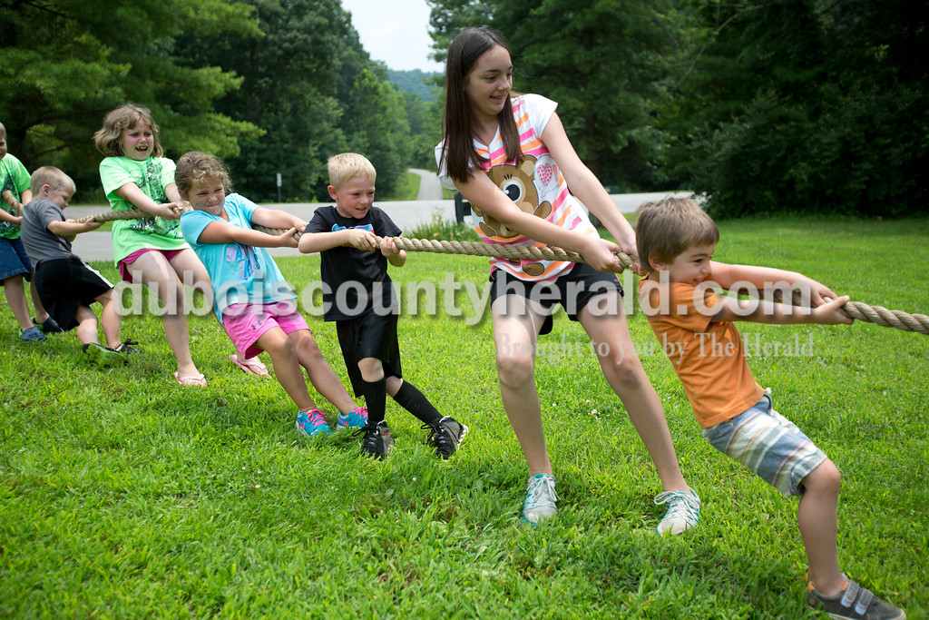 Erica Lafser/The Herald<br /> Children of all ages played a game of tug-o-war on Sunday during the Patoka Lake's Pirate Day Celebration at the Patoka Lake Nature Center. These activities were supposed to take place at the beach, but since it was flooded they had to relocate to the nature center.