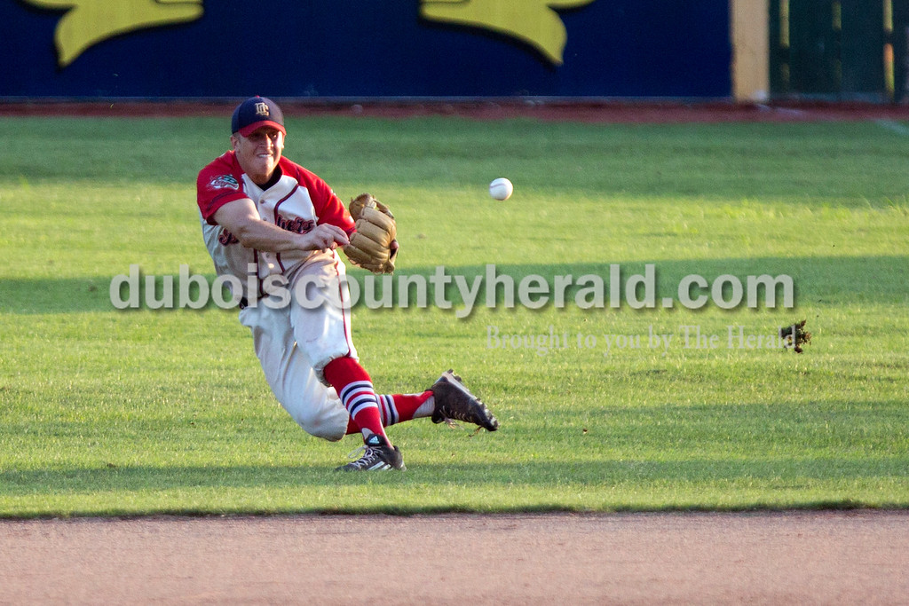 Ariana van den Akker/The Herald<br /> Bomber's Nick Gobert tossed the ball to first as he tumbled during Monday night's game against the Hoptown Hoppers at League Stadium in Huntingburg. The Bombers won 5-3.