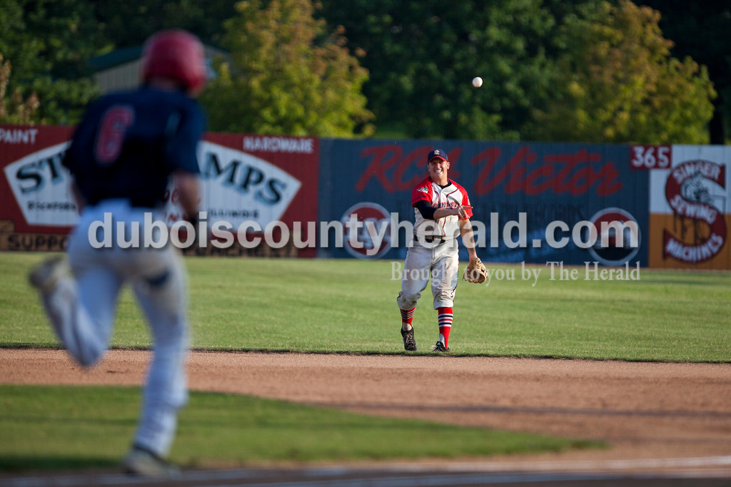 Dubois County Bombers' Nick Gobert fielded the ball to first base during Wednesday night's Bombers game against the the Owensboro Oilers at League Stadium in Huntingburg. <br /> Alisha Jucevic/The Herald
