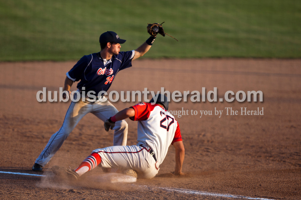 Brazton Morris caught the ball at third, forcing out Dubois County Bombers Mark Giesler during Wednesday night's Bombers game against the the Owensboro Oilers at League Stadium in Huntingburg. <br /> Alisha Jucevic/The Herald