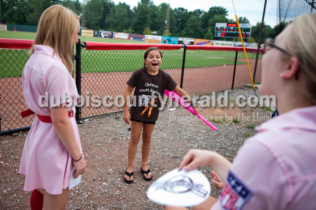 """As she waited for her turn at water balloon baseball, Brianna Nelson  of Jasper, 8, chatted with Peaches, Jessica Oser, 20, and Mikayla Sander, 18, both of Huntingburg, on Saturday night at the Dubois County Bombers game in Huntingburg. Barely holding in her excitement, Brianna jumped up and down. """"I've never gotten to do something like this and I'm so happy."""" <br /> Alisha Jucevic/The Herald"""