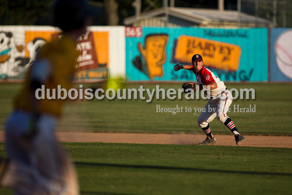 Dubois County Bombers' Jacob Snodgrass threw to first during Game 3 of the Ohio Valley League championship series against the Madisonville Miners on Friday night at League Stadium in Huntingburg. The Bombers defeated the Miners 3-2. <br /> Alisha Jucevic/The Herald